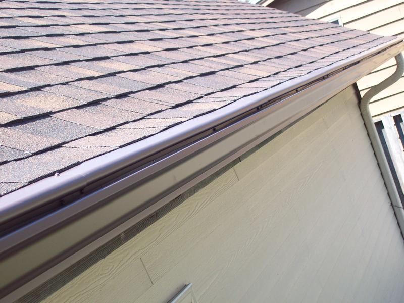 how to clean gutters with covers